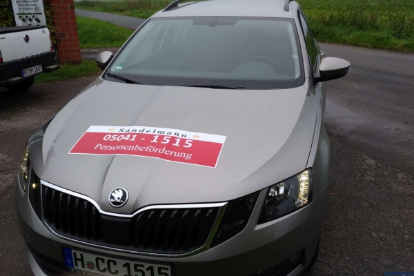 fahrzeugbeschriftung-taxi-sandelmann-01-h850F9261966-A97B-7424-E2AD-B8C2C0A5CB86.jpg
